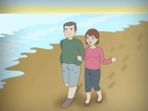 Pareja de jubilados paseando por la playa