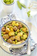 Cerdo con patatas y guisantes
