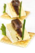 Canapés de queso y anchoa